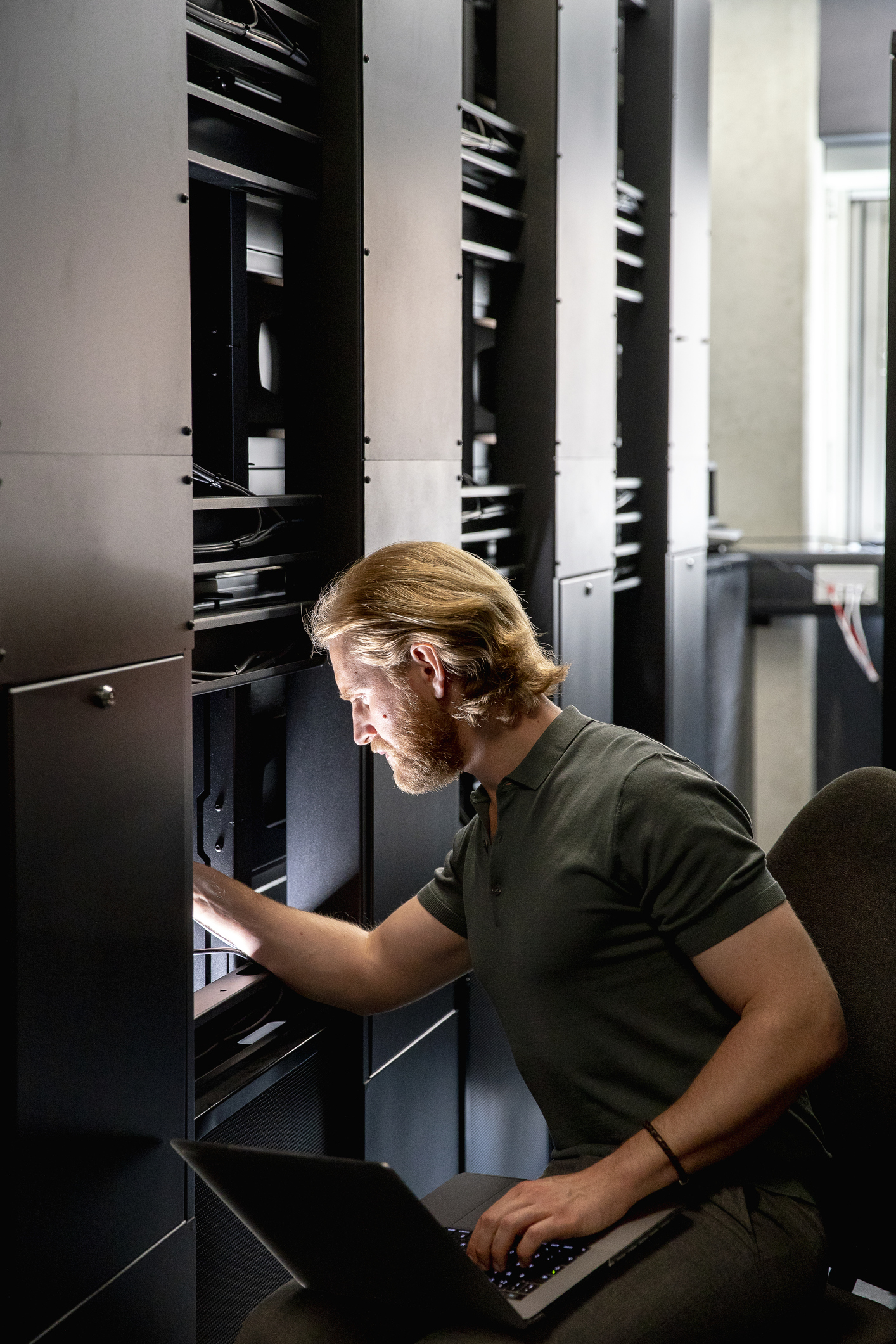 man checking servers for security breech